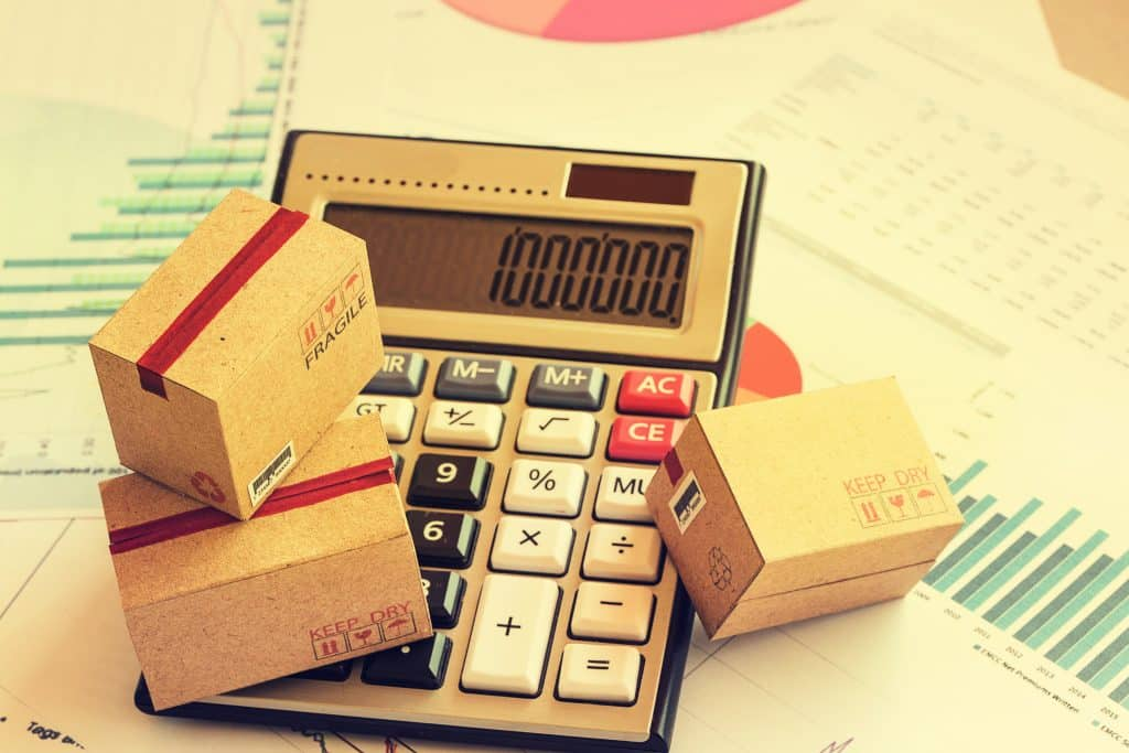 closeup,three,cardboard,boxes,packing,the,product,and,calculator,on