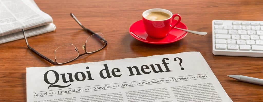 a,newspaper,on,a,wooden,desk, ,whats,new,in