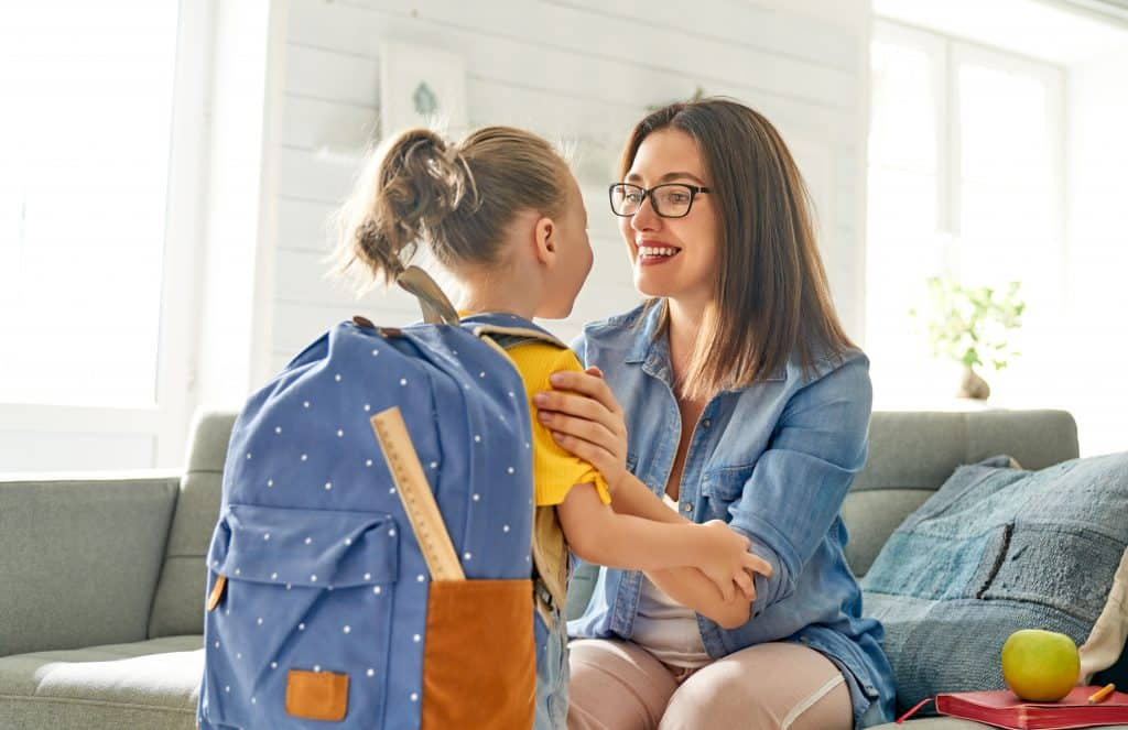 parent,and,pupil,of,preschool.,woman,and,girl,with,backpack